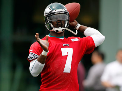 Eagles QB Michael Vick will look to reduce the number of batted passes he throws in 2012. (AP Photo/Alex Brandon)