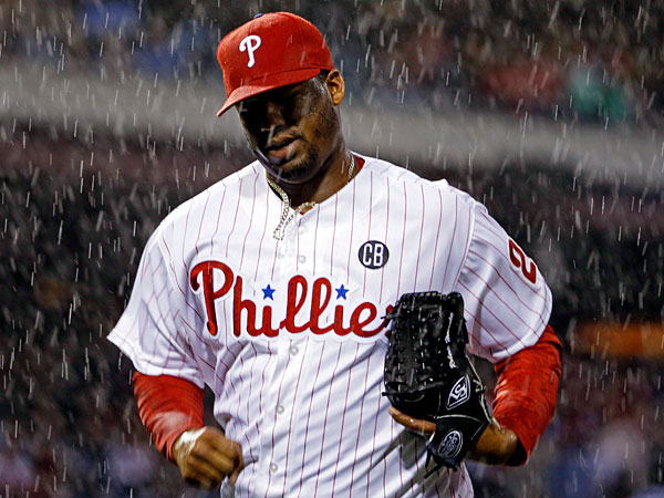 Roberto Hernandez makes his way to the dugout after play was suspended due to rain during the fourth inning of a baseball game against the Los Angeles Dodgers, Friday, May 23, 2014, in Philadelphia. (Matt Slocum/AP)