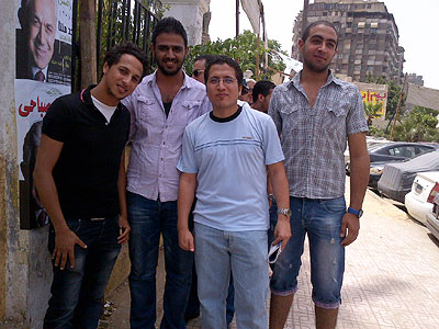 This group of university students in a Cairo voting line was still debating over whether to vote for a leftist, nationalist or a moderate Islamist. (Trudy Rubin / Staff)