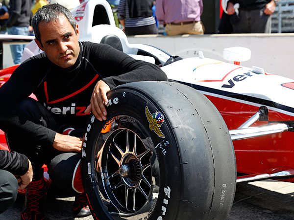 Juan Pablo Montoya, of Colombia, sits next to his car as he waits for his turn to qualify during qualifications for Indianapolis 500 IndyCar auto race at the Indianapolis Motor Speedway in Indianapolis. Montoya needed four races to get comfortable again in an Indy car. His feel has returned just in time for the Indianapolis 500, the race he won in 2000. (Tom Strattman/AP)