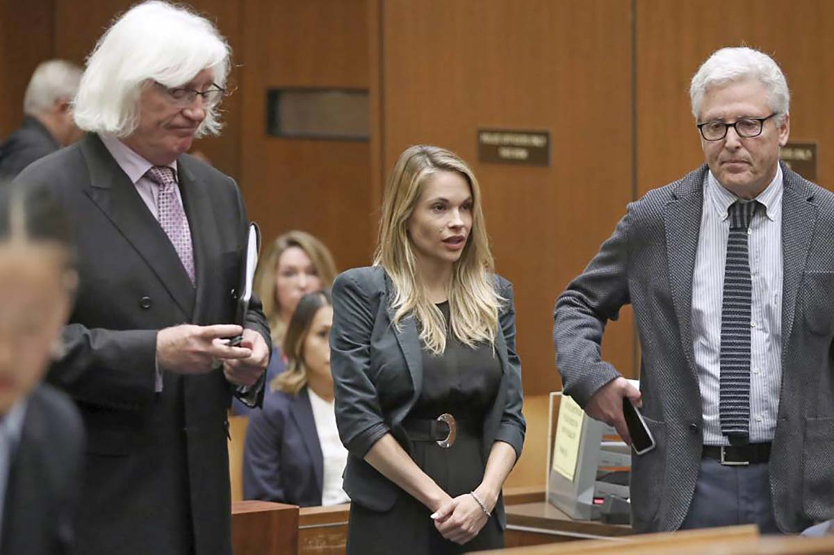 "Danielle ""Dani"" Mathers, center, answers the judges´s questions with her attorneys Tom Mesereau, left, and Dana M. Cole Wednesday, May 24, 2017, to answer charges related to her taking a photo of a naked, 71-year-old woman in a gym locker room and posting it on social media with insults about the woman´s body, in Los Angeles County Superior Court in Los Angeles. She pleaded no contest and was sentenced to probation and 30 days of community service. (Frederick M. Brown/Pool photo via AP)"