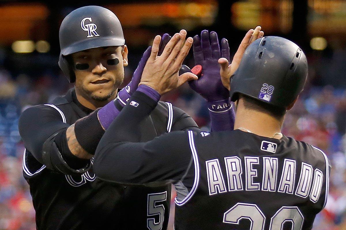 The Rockies´ Carlos Gonzalez (left) celebrates his three-run home run with teammate Nolan Arenado against the Phillies.