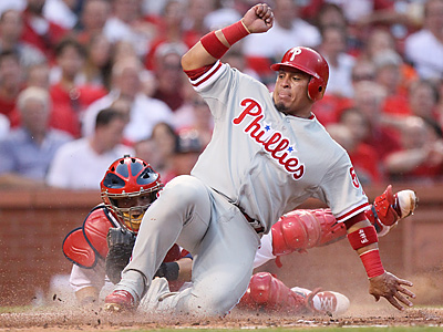 Carlos Ruiz scores against the Cardinals during the Phillies 10-9 win on Thursday night. (AP Photo/Chris Lee, Post Dispatch)