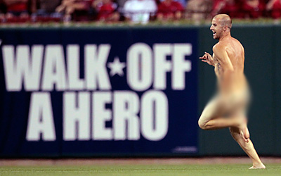 Possibly the best photo of a streaker ever taken.  (AP Photo/Jeff Roberson)