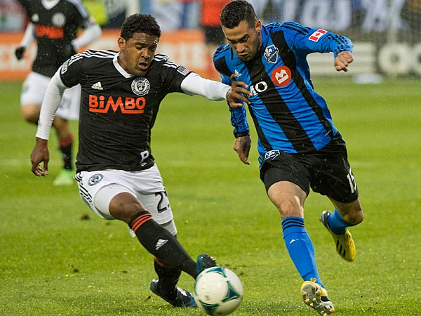 Montreal Impact&acute;s Andres Romero, right, breaks away from Philadelphia<br />Union&acute;s Sheanon Williams during the first half of an MLS soccer game<br />in Montreal, Saturday, May 25, 2013. (AP Photo/The Canadian Press,<br />Graham Hughes)