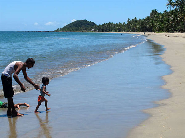 A romp at Pacific Harbour Beach in Fiji. A fringe of coconut trees gives way to a gorgeous, pristine beach with a gentle arc and placid waters warm as a bath. (Nick Perry/AP)