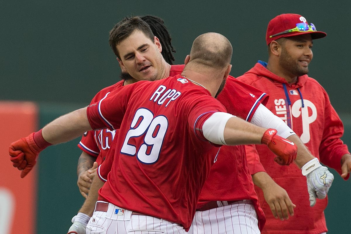 Tommy Joseph celebrates the win with catcher Cameron Rupp.