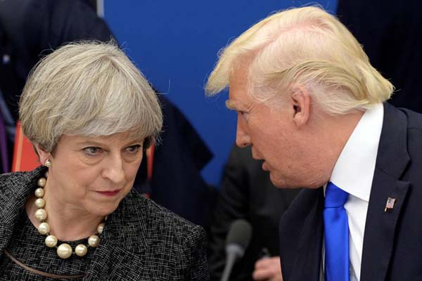 U.S. President Donald Trump, right, speaks to British Prime Minister Theresa May in a working dinner meeting during the NATO summit of heads of state and government at the NATO headquarters, in Brussels on Thursday, May 25, 2017. US President Donald Trump inaugurated the new headquarters during a ceremony on Thursday with other heads of state and government.