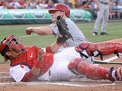 Phillies catcher Carlos Ruiz tags Cincinnati´s Jay Bruce in the second inning. (Steven M. Falk / Staff photographer)