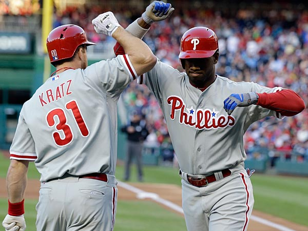 Philadelphia Phillies´ Domonic Brown, right, and Erik Kratz celebrate after Brown´s solo home run during the second inning of a baseball game against the Washington Nationals at Nationals Park Saturday, May 25, 2013, in Washington. Kratz also hit a solo home run at his next at bat. (AP Photo/Alex Brandon)