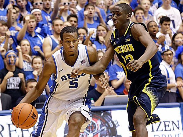 Duke´s Rodney Hood drives to the basket as Michigan´s Caris LeVert defends. (Gerry Broome/AP)