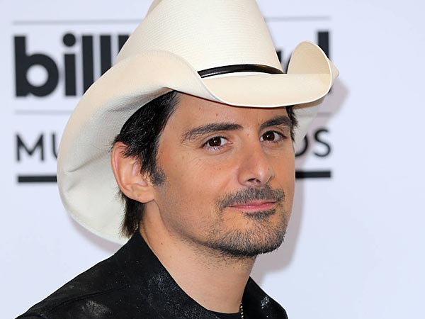 Country music singer Brad Paisley performed during a troop rally with President Barack Obama during an unannounced visit at Bagram Air Field, on Sunday, May 25, 2014, north of Kabul, Afghanistan. (AP Photo/ Evan Vucci)