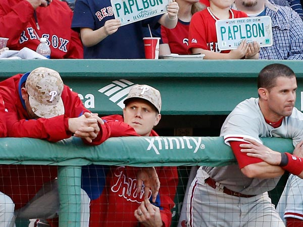 Former Red Sox closer Jonathan Papelbon (center) watches the game in the first inning at Fenway Park. (Michael Dwyer/AP)