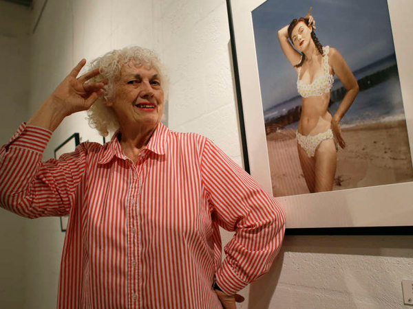 Bunny Yeager poses in 2013 next to a self-portrait from 1952. (LYNNE SLADKY / ASSOCIATED PRESS)