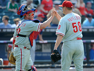 Brian Schneider started at catcher for the Phillies on Sunday after Carlos Ruiz was scratched. (Kathy Kmonicek/AP)