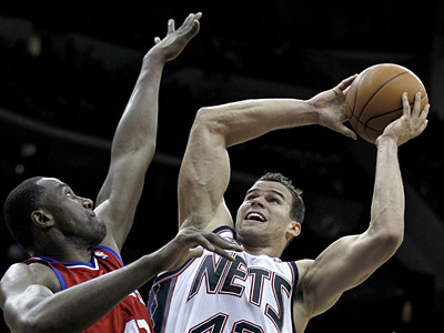 The Sixers could target free agent Kris Humphries (right) if the team and Elton Brand (left) part ways. (AP Photo/Julio Cortez)