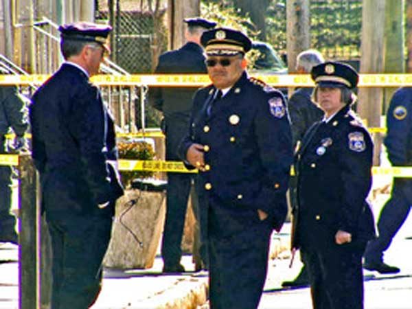 Police Commissioner Charles Ramsey (center) at the scene of a shooting. (File photo)