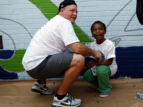 Head coach Chip Kelly, left, paints a mural with second-grader Theresa<br />Davis during the 17th annual Eagles Youth Partnership Playground Build<br />at the William D. Kelly School on May 29, 2013 in Philadelphia, Pa. <br />(David Maialetti / Staff Photographer)