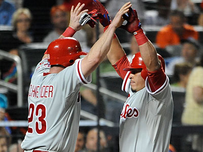 Brian Schneider and Carlos Ruiz celebrate Ruiz´s two-run homer in the seventh inning. (Kathy Kmonicek/AP)