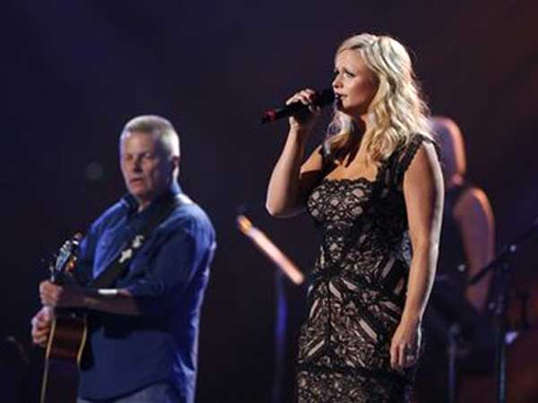 This image released by NBC Universal shows country singer Miranda Lambert, right, during the Healing in the Heartland (AP Photo)