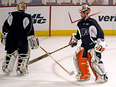 Flyers goalies Brian Boucher, left, and Michael Leighton take part in Sunday´s practice. ( Ron Cortes / Staff Photographer)