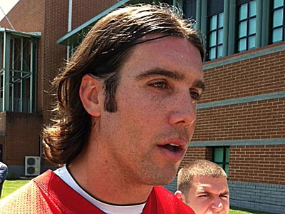 Trent Edwards talks to reporters after practice. (Photo by Les Bowen)
