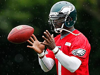 Eagles QB Michael Vick can burn blitzing defenses with his legs. (Matt Rourke/AP)