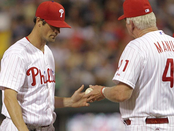 The Phillies´ Cole Hamels hands the ball to Manager Charlie Manual during the 6th inning of a game against the Milwaukee Brewers at Citizens Bank Park in Philadelphia, Friday, May 31, 2013. Brewers beat the Phillies 8-5. (Steven M. Falk/Staff Photographer )