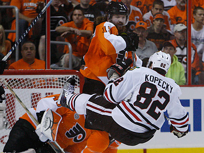The Flyers´ Scott Hartnell sends the Blackhawks´ Tomas Kopecky flying during the second period. (Ron Cortes / Staff Photographer)