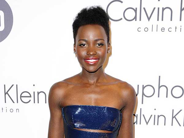 """FILE - This May 15, 2014 file photo shows Lupita Nyong´o at the IFP and Calvin Klein Women In Film Party at the 67th international film festival, Cannes, southern France. The Walt Disney Co. announced Monday, June 2, that Nyong'o is joining the cast of """"Star Wars: Episode VII.â€� The 31-year-old actress became a breakthrough star for her award-winning performance in """"12 Years a Slave.â€� (AP Photo/Arthur Mola/Invision/File)"""