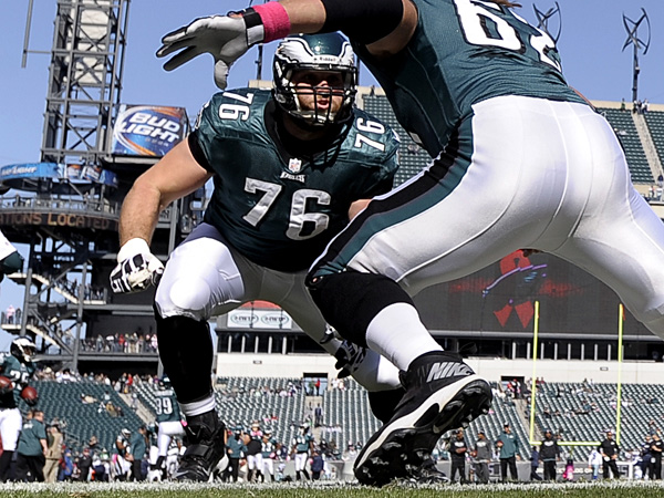 Eagles tackle Allen Barbre (76) and center Jason Kelce (62) work on blocking before a game in 2013. (AP Photo/Michael Perez)<br />