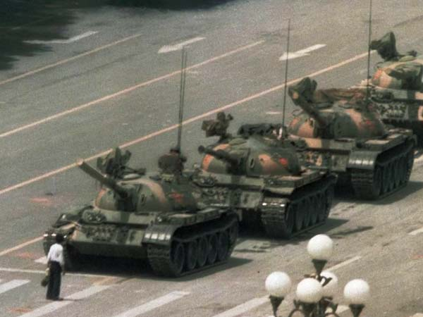 FILE - In this June 5, 1989 file photo, a Chinese man stands alone to block a line of tanks heading east on Beijing´s Changan Blvd. from Tiananmen Square in Beijing. (AP Photo/Jeff Widener, File)