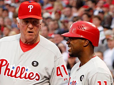 Charlie Manuel checks on Jimmy Rollins after he fouled a ball off his knee in the first inning. (Gene J. Puskar/AP)