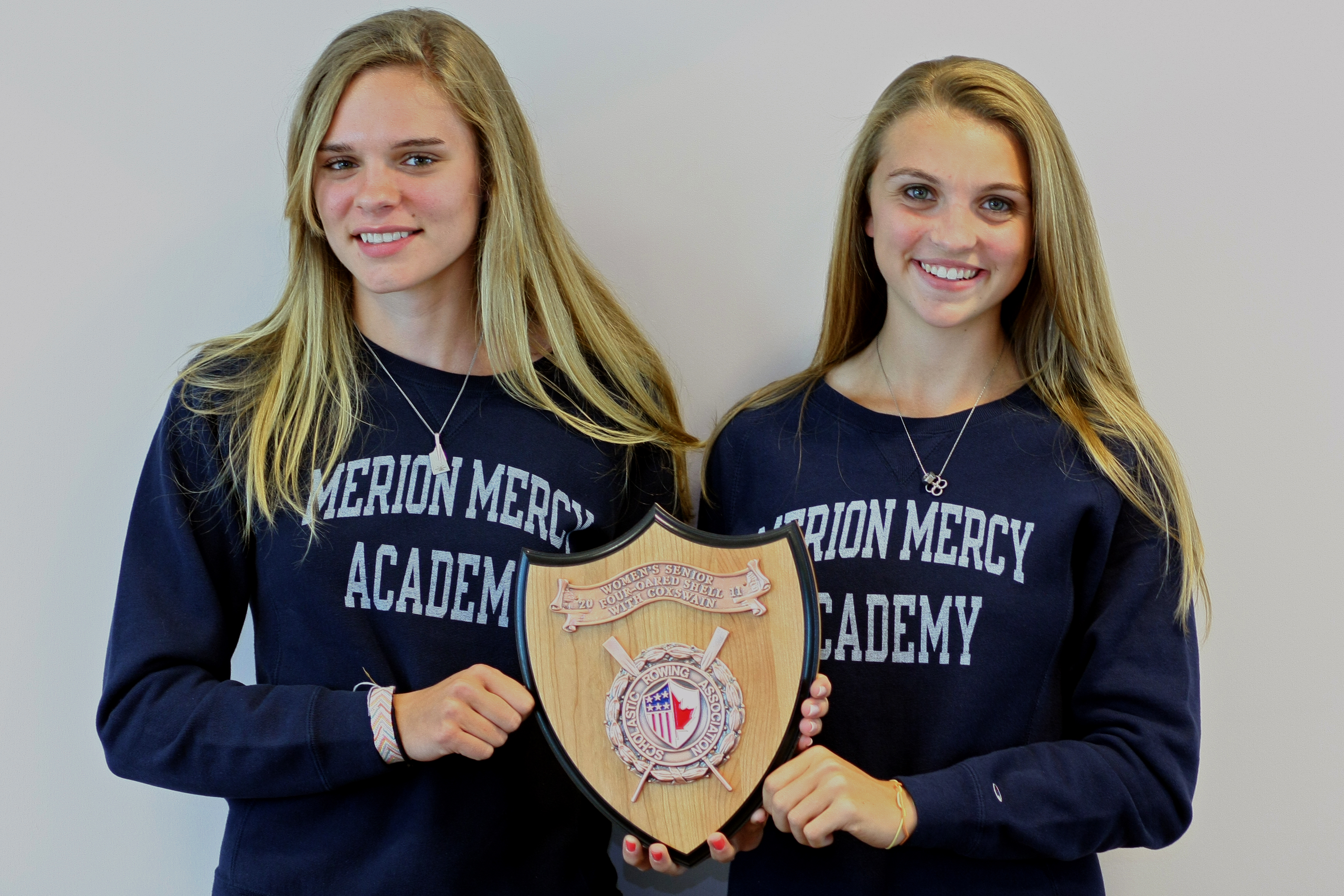 Merion Mercy seniors Amanda Lorei (left) and Sara Romano, with the championship plaque that the Golden Bears´ varsity four with coxswain won at the SRAA rowing nationals Saturday in Pennsauken, N.J. (Lou Rabito / Staff)