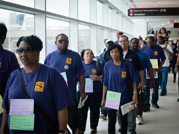 FILE PHOTO - Airport workers and members of Service Employees International Union (SEIU). (Source: SEIU 32BJ local)