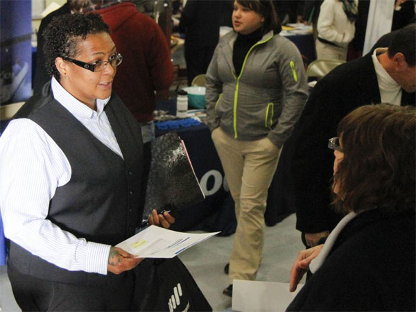 In this May 16, 2014 photo, Megan Lory, left, talks with Sandra Modena, Sales Manager at Trillium Staffing, at the annual veterans job fair aboard the LST in downtown Muskegon, Mich. Payroll processor ADP reports how many jobs private employers added in May on Wednesday, June 4, 2014. (AP Photo / The Muskegon Chronicle, Madelyn Hastings)