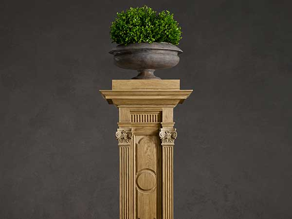 This photo provided by Restoration Hardware shows a carved oak plinth that makes a statement, and can be used to hold artwork, plants or as a side table. Architectural fragments, Italian etchings of Greco-Roman architecture, and reproduction plaster busts are part of a large range of decorative elements that evoke neoclassical décor at Restoration Hardware. (AP Photo/Restoration Hardware)