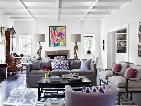 In this photo provided by Burnham Design, shades of purple and lavender are mixed with softer shades of gray and black accents in a living room designed by Betsy Burnham of Burnham Design. (AP Photo/Burnham Design, Sarah Dorio)
