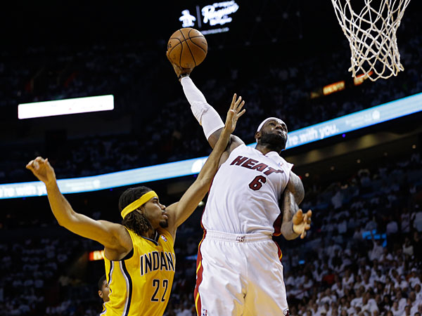LeBron James (6) drives to dunk the ball over Indiana Pacers forward Chris Copeland (22) during the second half Game 6 in the NBA basketball playoffs Eastern Conference finals on Friday, May 30, 2014, in Miami. (Lynne Sladky/AP)