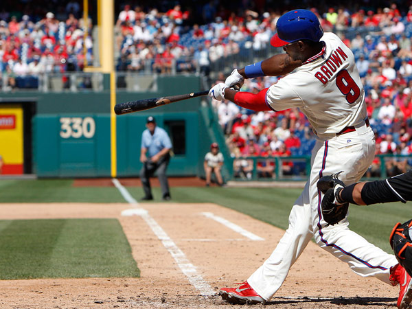 Domonic Brown hits a two-run homer, his 18th of the season, during the seventh inning of the Phillies´ 6-1 win over the Marlins.
