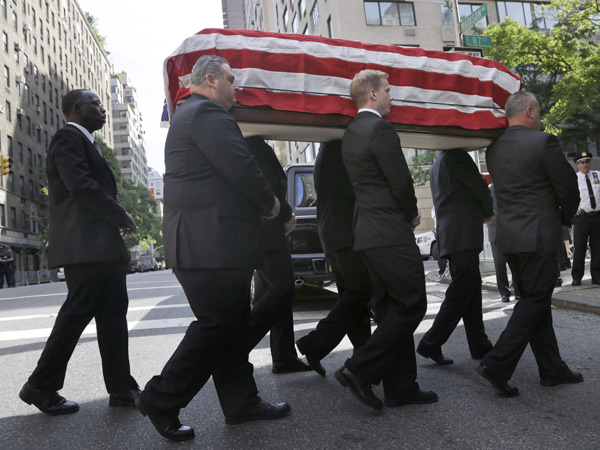 The casket containing the body of  U.S. Sen. Frank Lautenberg is carried into the Park Avenue Synagogue in New York, Wednesday, June 5, 2013. Lautenberg´s nearly three decades in office and the causes he championed will be remembered at a funeral service in New York. (AP Photo/Seth Wenig)