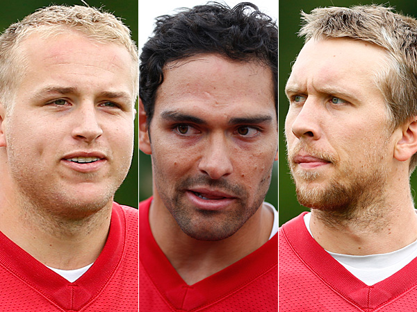 Eagles quarterbacks Matt Barkley (left), Mark Sanchez (center), and Nick Foles (right). (Matt Rourke/AP Photos)