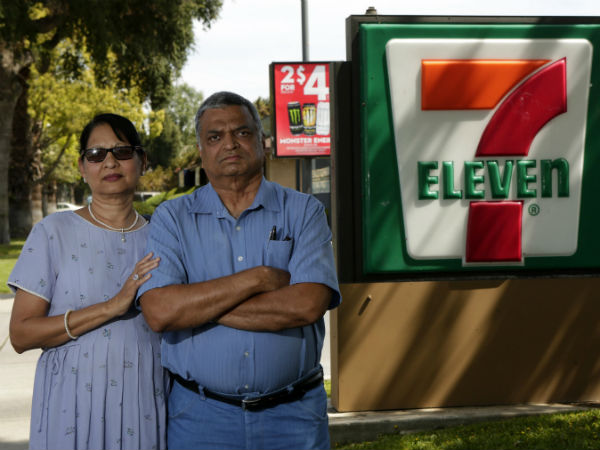 """Saroj Patel, left, and her husband, Dilip, allege 7-Eleven used """"storm trooper interrogation and isolation tactics"""" to strip them of the Riverside, Calif., store that they had run since 1995. (Irfan Khan / Los Angeles Times / MCT)"""