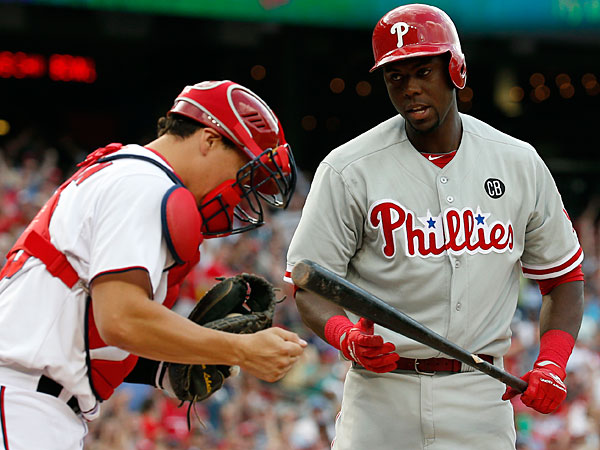 Nationals catcher Jose Lobaton pumps his fist as Philadelphia Phillies´ John Mayberry Jr., right, steps away after he made the last out of the ninth inning of a baseball game at Nationals Park Thursday, June 5, 2014, in Washington. The Nationals won 4-2. (Alex Brandon/AP)