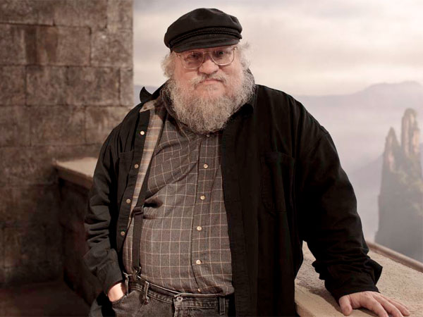 "In this publicity image released by HBO, author George R.R. Martin whose novel series have been adapted into the HBO series ""Game of Thrones,"" is shown on the set. ""Game of Thrones"" was nominated for an Emmy Award for best television drama series on July 14, 2011.  (AP Photo/HBO, Nick Briggs )"