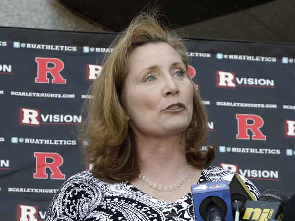 Rutgers incoming athletic director Julie Hermann answers a question during a news conference outside of the university´s Hale Center in Piscataway, N.J., Wednesday, June 5, 2013. Hermann says the problems she encountered as a women´s volleyball coach at Tennessee are part of the reason she´s a good fit as a sports administrator. (AP Photo/Mel Evans)