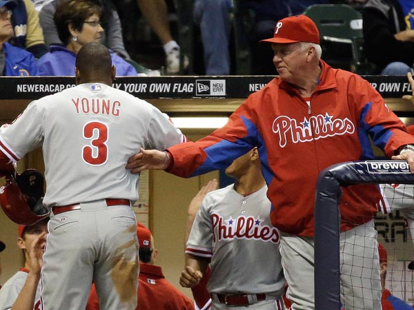 Charlie Manuel (right) congratulates Delmon Young (3) after Young&acute;s home run during the fifth inning of a baseball game against the Milwaukee Brewers, Thursday, June 6, 2013, in Milwaukee. (Morry Gash/AP)<br />