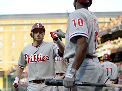Mike Fontenot celebrates his two-run home run against the Orioles with Juan Pierre. (Nick Wass/AP)