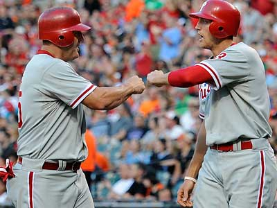 Jim Thome and Hunter Pence celebrate after they scored on a double by Shane Victorino on Friday. (Nick Waas/AP)
