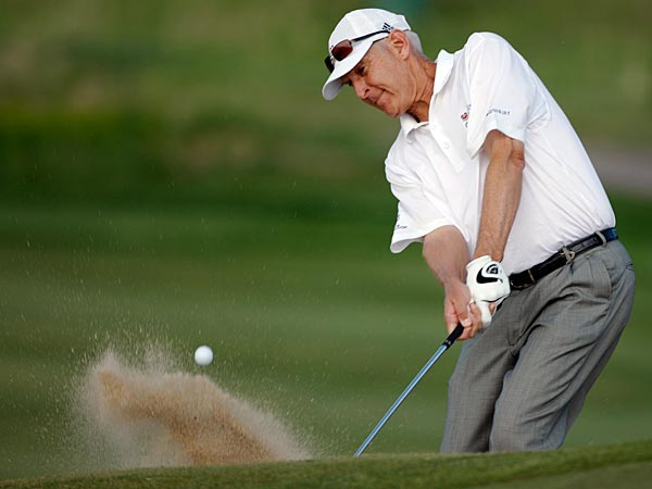 Andy North chips out of the sand to reach the 11th green during the opening round of the Senior PGA Championship golf tournament in Parker, Colo., on Thursday, May 27, 2010. (AP Photo/David Zalubowski)